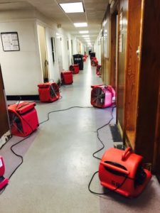 Our industrial sized air movers dry up water damage quickly in commercial buildings.