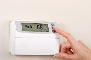 Adjusting and setting thermostat to save energy