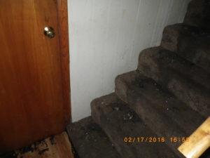 fire damage restoration basement living room before