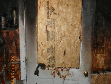 fire damage restoration garage entrance before