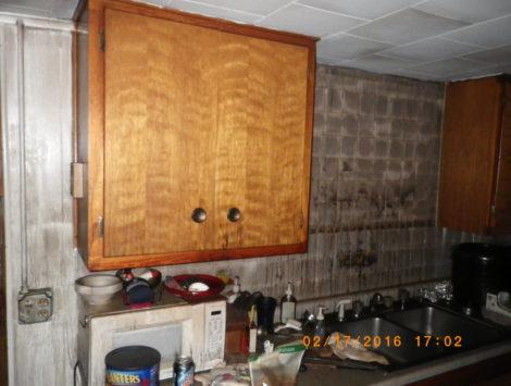 fire damage restoration basement kitchen before