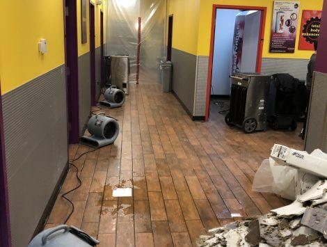 frozen pipe burst water damage in hallway